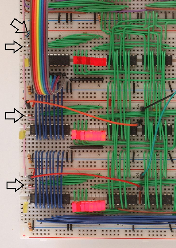 The logic boards showing, from top to bottom, the AND, OR and XOR outputs. The arrows point to the diodes and resistor forming a diode AND gate.
