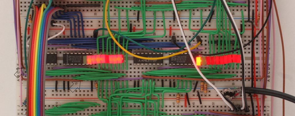 The W and Z registers with arrows highlighting the brown wires carry W bit 7 (w7) and W bit 0 (w0) to the flags circuitry.